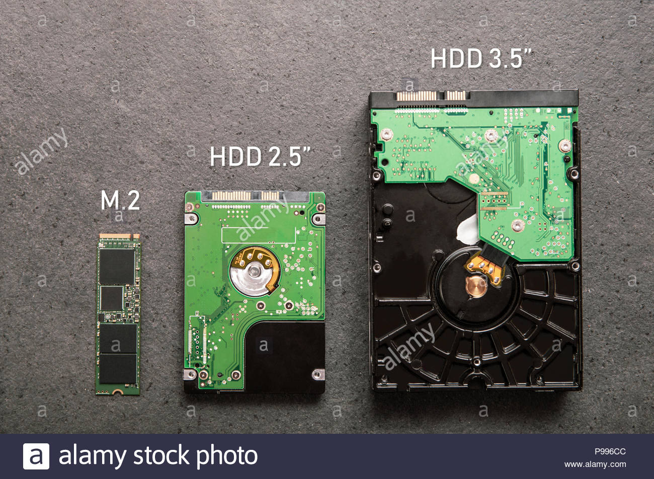 three-drives-arranged-on-a-stone-slab-comparison-of-ssd-m2-drive-with-hdd-25-and-35-P996CC.jpg